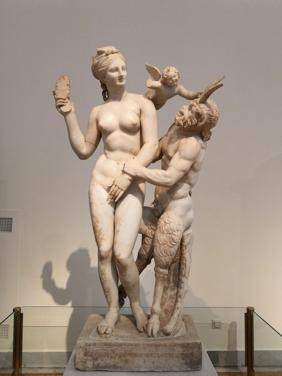 Group of Aphrodite, Pan and Eros. Parian marble. Found in the 'House of Poseidoniastai or Beryttos' (Beirut), Delos. About 100 BC.
