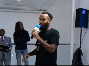 Nate the Lyricist on the left performing and Caro Sika interviewing Paul Muhammad on the right