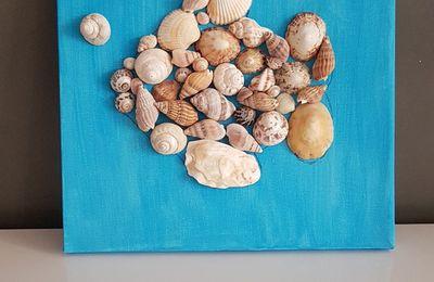 Notre tableau avec des coquillages.