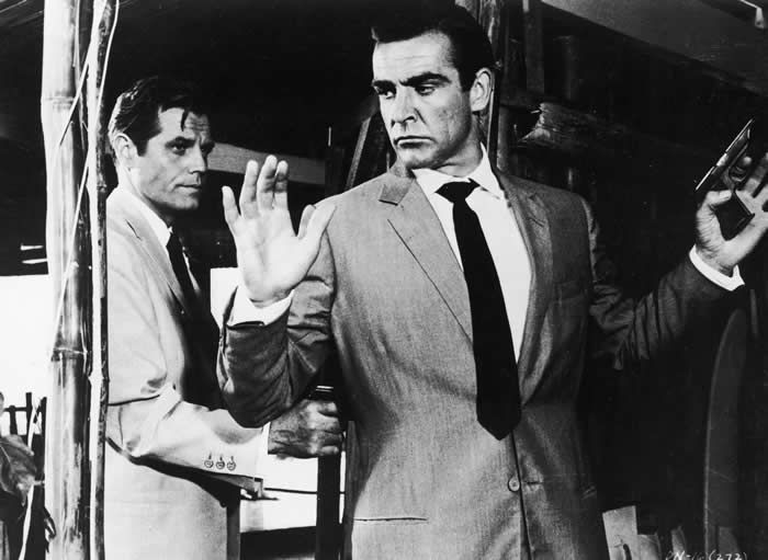 """Mr. Connery, with Jack Lord, in his first James Bond film, """"Dr. No,"""" in 1962.Credit...United Artists, via Getty Images"""