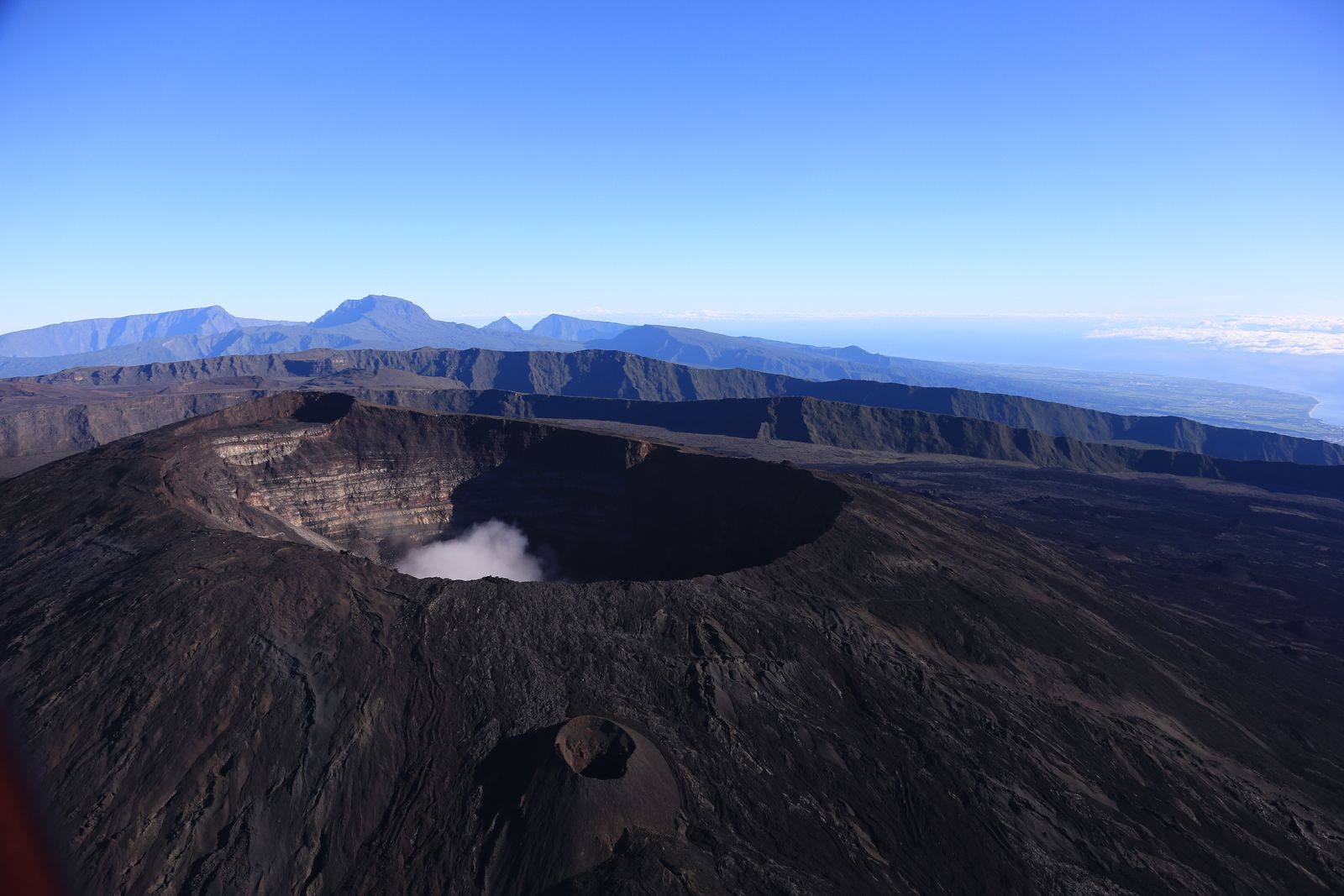 """LaRéunion - Piton de La Fournaise - east and northeast flanks of the Dolomieu, with a cloud """"trapped"""" in the crater - photo archives © Bernard Duyck"""