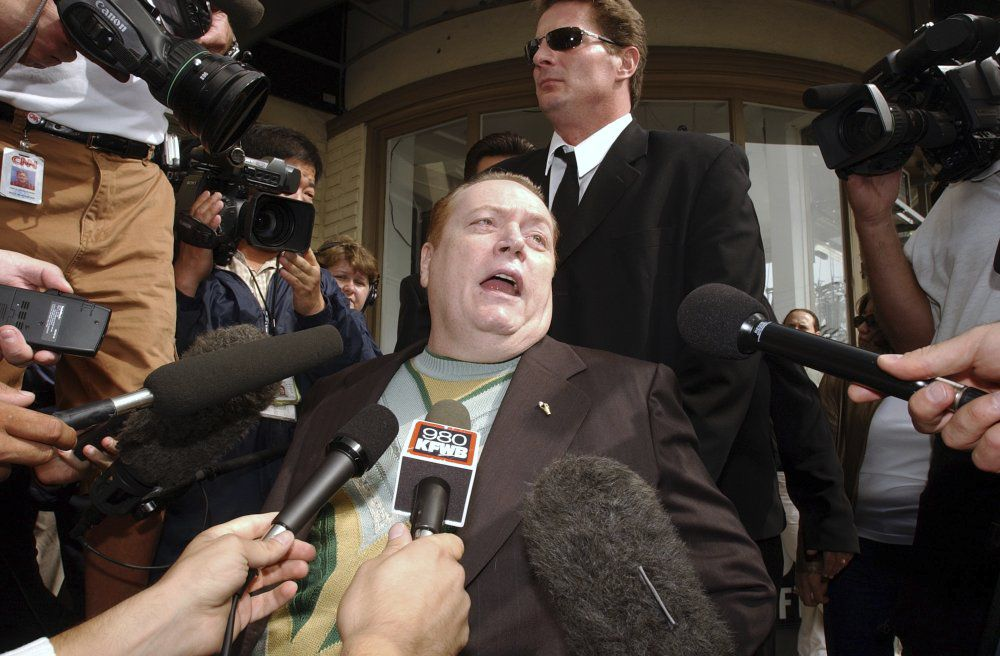 "FILE - ""Hustler"" magazine founder and gubernatorial candidate Larry Flynt talks to reporters as he arrives to cast his vote in the recall election, Tuesday, Oct. 7, 2003, in West Hollywood, Calif. Flynt, who turned ""Hustler"" magazine into an adult entertainment empire while championing First Amendment rights, has died at age 78. His nephew, Jimmy Flynt Jr., told The Associated Press that Flynt died Wednesday, Feb. 10, 2021, of heart failure at his Hollywood Hills home in Los Angeles. (AP Photo/Rene Macura, File)"
