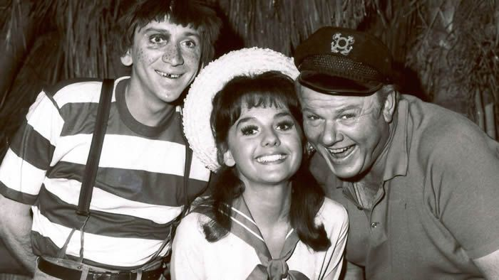 "In this 1965 photo, Dawn Wells, center, poses with fellow cast members of ""Gilligan's Island,"" Bob Denver and Alan Hale Jr., in Los Angeles. Wells died early Wednesday, Dec. 30, 2020, in Los Angeles, of causes related to COVID-19. [ ANONYMOUS 