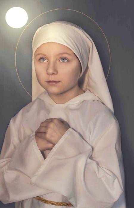 """Bienheureuse Imalda Lambertini, surnommée """"la fleur de l'Eucharistie"""", patronne des premiers communiants."""