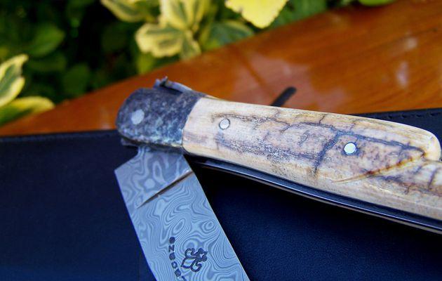 Couteau Laguiole ivoire de mammouth feuilles de chêne et bécasse cisele au burin