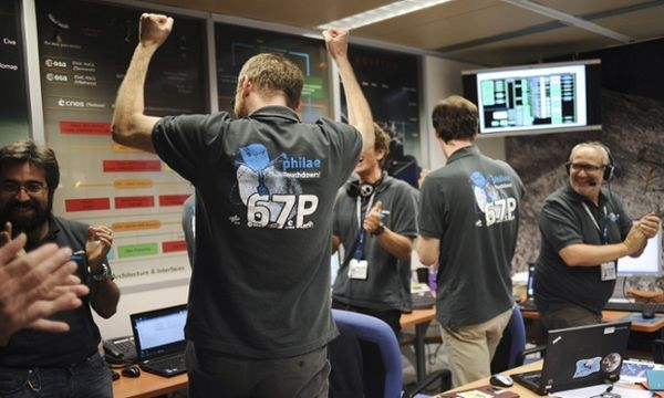 Scientists celebrate in the scientific mission observation centre of the French space agency Centre National d'Etudes Spatiales in Toulouse as they receive information that the European Space Agency's robot craft Philae has landed on the Churyumov-Gerasimenko comet. Photograph: REMY GABALDA/AFP/Getty Images
