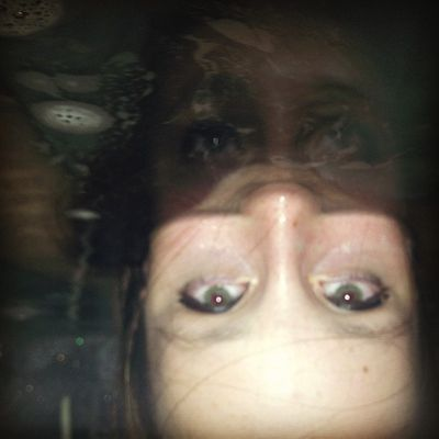 """""""#Reflection """" currently making some #useless #pics in the #water U__U now that I've got my  #lifeproof #iphone #case!  #girl #look #eyes #blue #photo #fun #space #bath #home"""