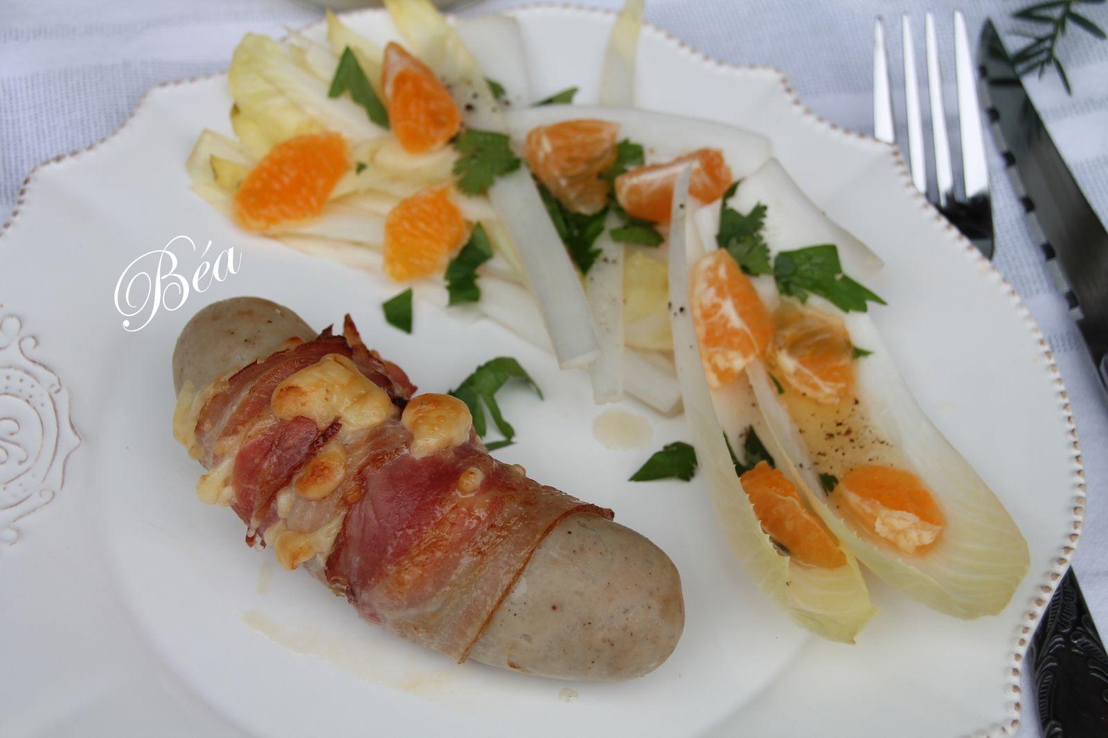 Boudins blancs lardés, purée de pommes de terre à l'huile à la truffe et salade d'endives à la clémentine