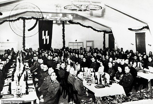 Berger had admitted guarding prisoners in the camps, which were part of the infamous Neuengamme network, but said he had not observed any mistreatment or overseen an evacuation. Pictured: Christmas celebration of the SS guards at Concentration Camp Neuengamme in 1943
