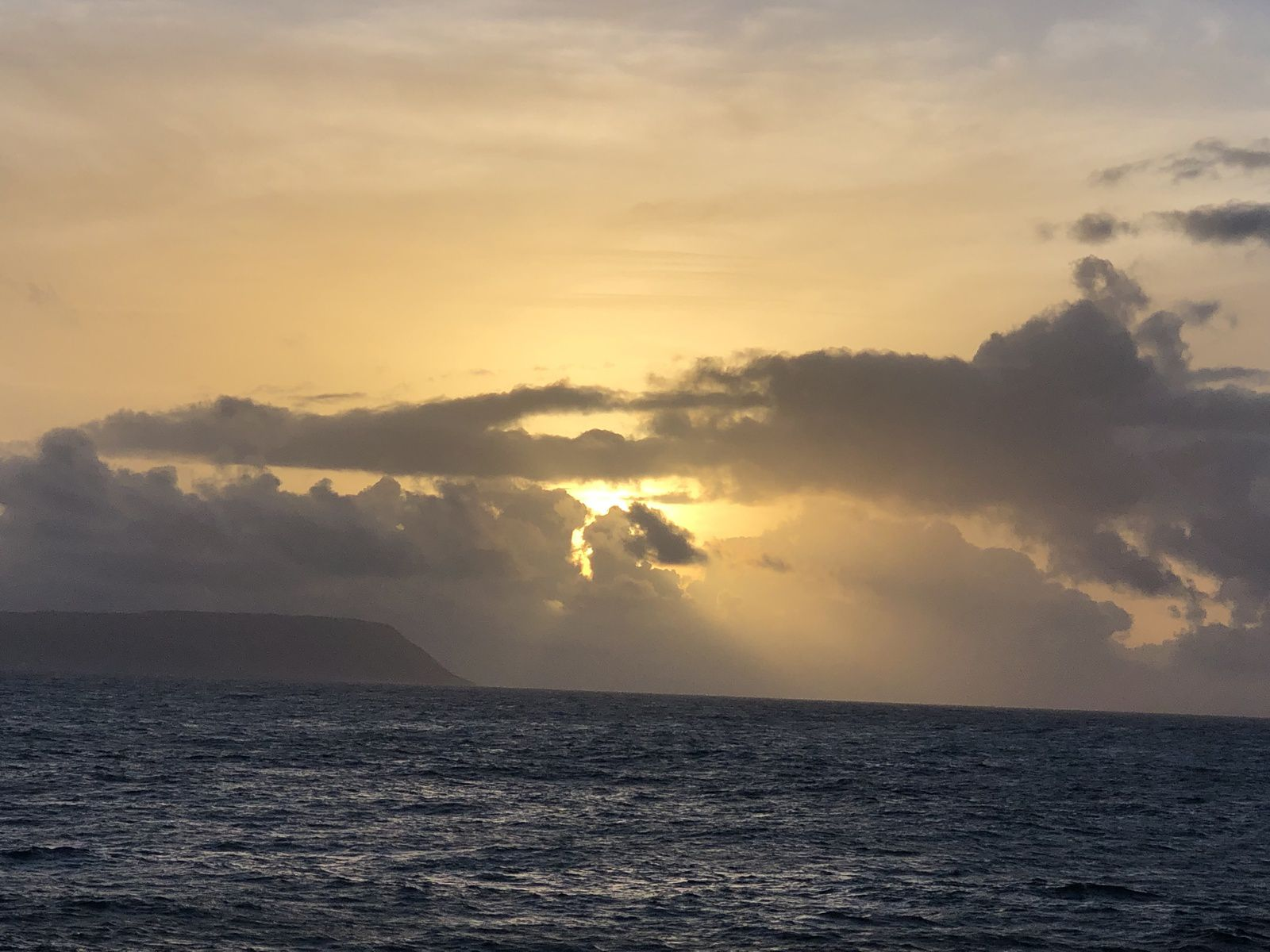 Morning Sun shining through clouds at Pointe des Châteaux