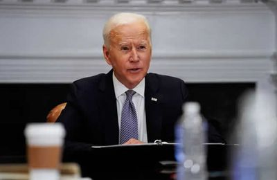 Biden urges Russia to de-escalate Ukraine tensions in call with Putin