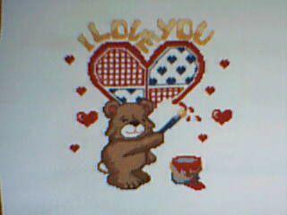 un petit nounours en coeur