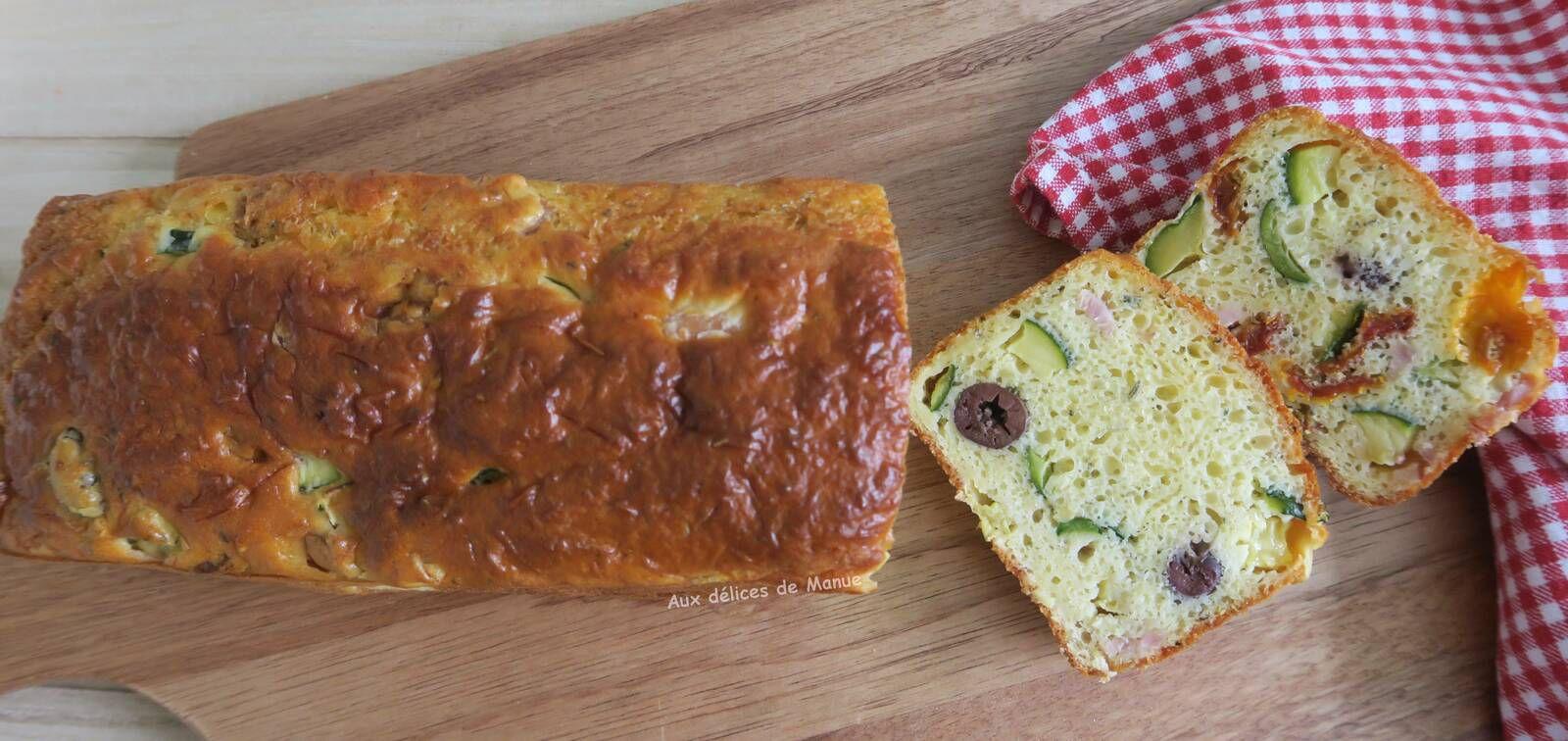 Cake à la courgette, tomates séchées, rôti de porc, olives et emmental