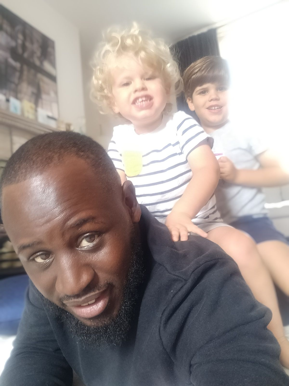 Joss with two of his young learners