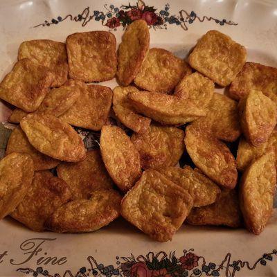 Bouchées apéritives à l'emmental et au curry