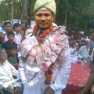 অভিনব পন্থায় MP তোফায়েলকে বরণ করে নিল জনতা।