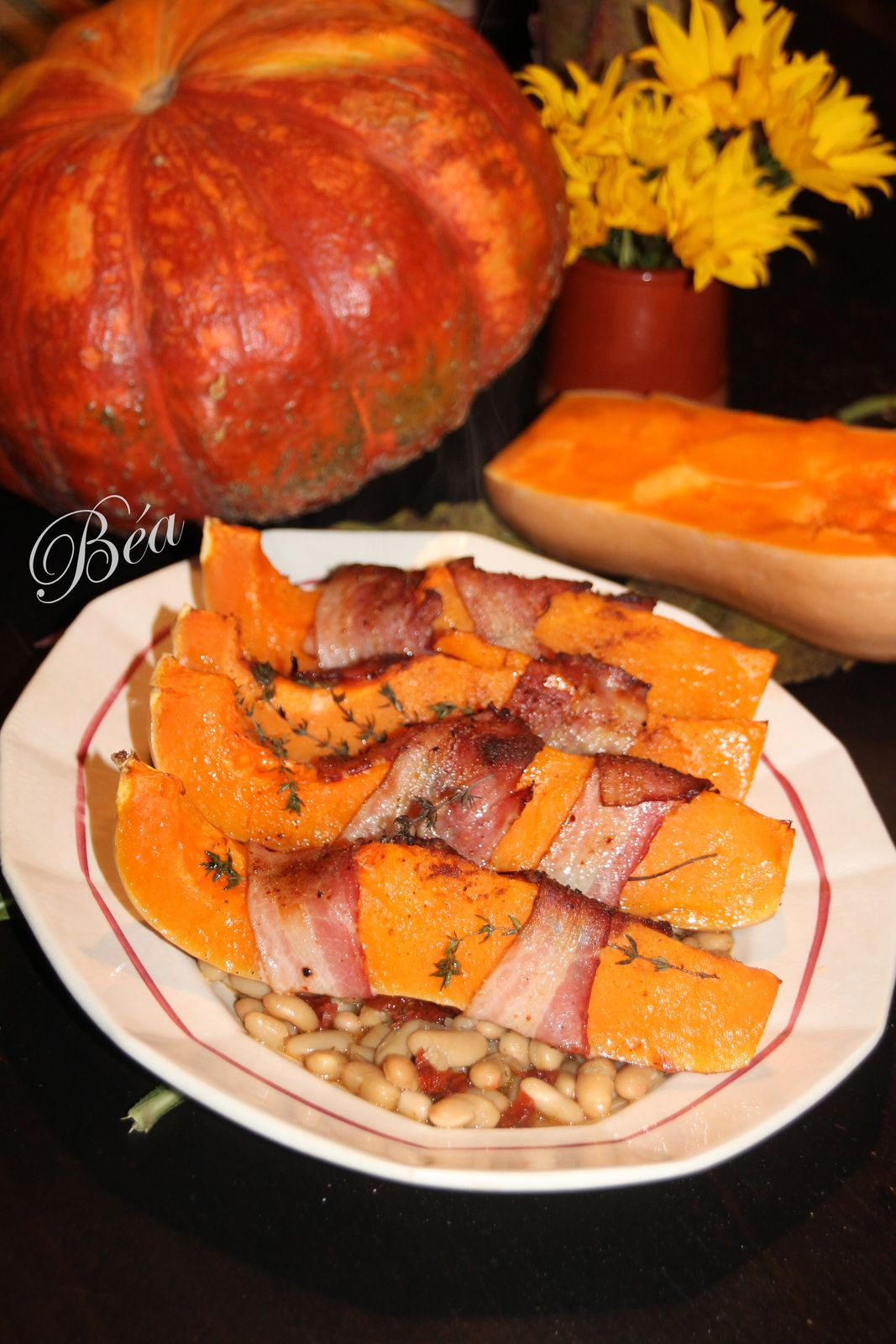 Butternut rôtie au lard fumé et haricots aux tomates séchées confites