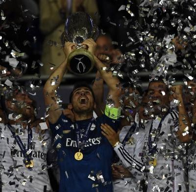 Real Madrid's captain Iker Casillas holds up the trophy after winning the UEFA Super Cup
