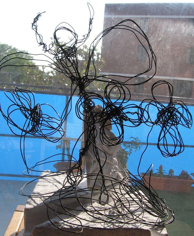 Ange et fleurs de fil de fer
