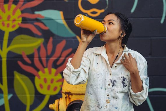 woman-drinking-water-from-insulated-water-bottle