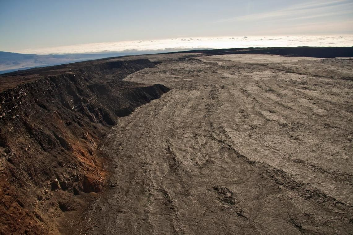 This view from the top of Mauna Loa looks northeast. The eastern flank of Mauna Kea is to the left, and North Pit, at the northeast end of Moku'āweoweo, is opposite - HVO-USGS photo - one click to enlarge