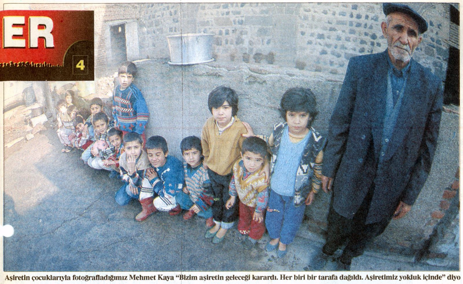 The fallen chief, surrounded by children of his tribe, poses for the  journalists (Sabah, January 6, 1997)