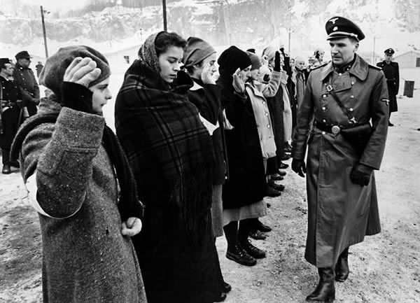 Relatives: Jennifer Teege, left, is the granddaughter of Nazi concentration camp boss Amon Goeth, right - Notorious: Goeth was played by Ralph Fiennes, right, in 1993 blockbuster Schindler's List