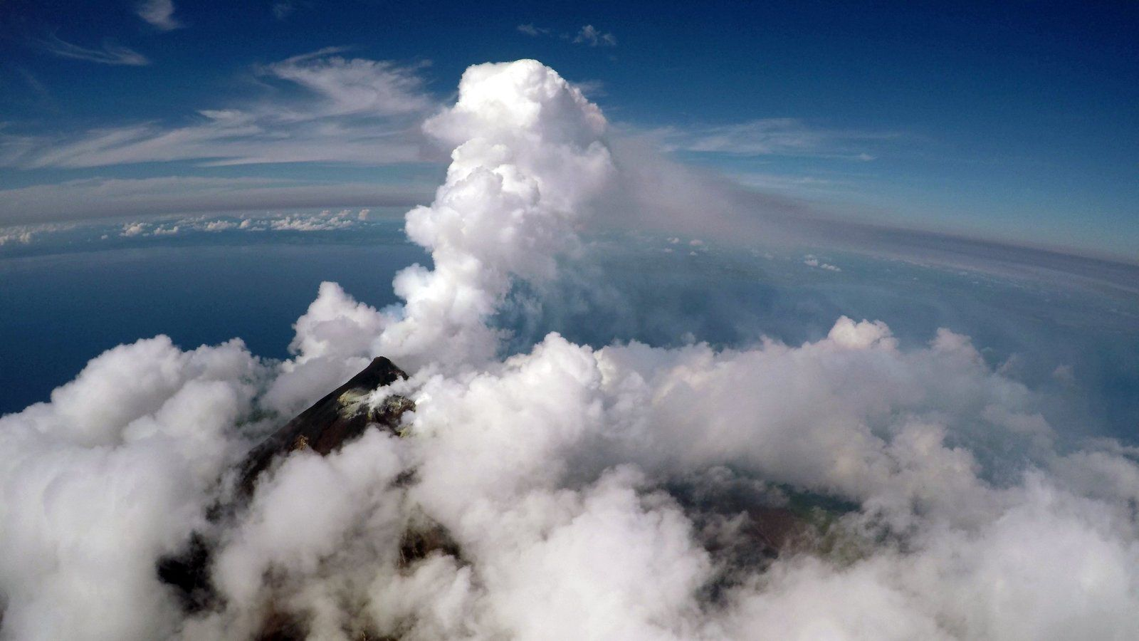 Manam - View from UAS during plume approach. The floating plume from the south crater rose to about 2-3 km above sea level before dispersing laterally - photo K. Wood 05.2019