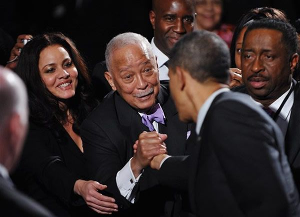 In this file photo taken on April 6, 2011, former New York City mayor David Dinkins greets U.S. President Barack Obama at the 20th anniversary National Action Network Gala at a hotel in New York City.MANDEL NGAN / AFP via Getty Images, file