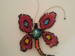 Un papillon que j'ai fait sur le modèle d'un autre papillon qu'on m'a offert il y a longtemps. J'ai galéré avant d'arriver à un résultat potable XD