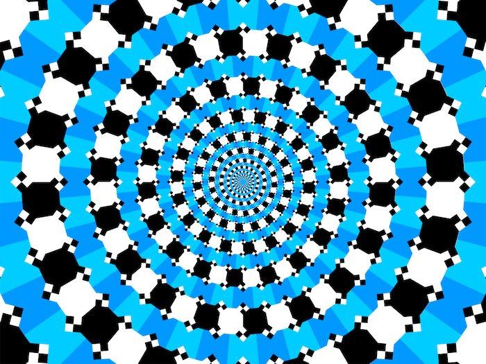 cercles en damier bleu sur fond en spirale noire et blanche semblent se terminer en spirale