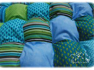 Edredon dans les tons turquoise bleu