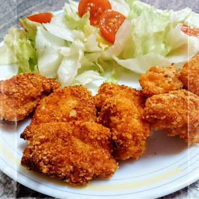 Mordiscos de pollo con almendra