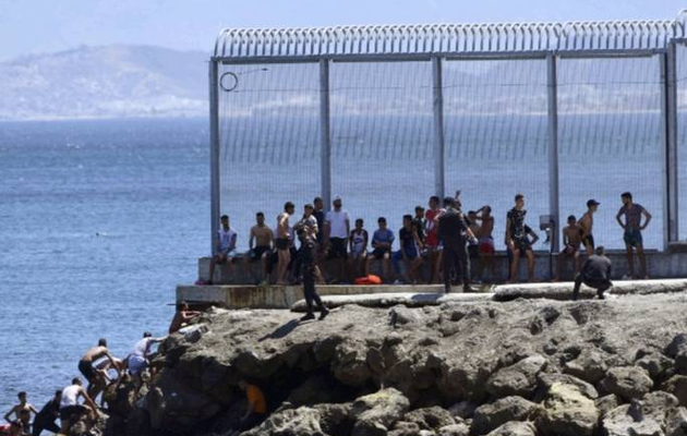 Record 2,700 migrants reach Spain's Ceuta enclave in one day