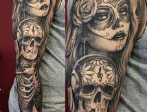 tatouage bras crâne et catrina