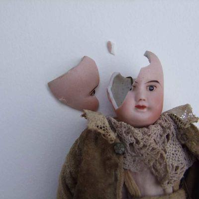 Restauration d'une tête de poupée :