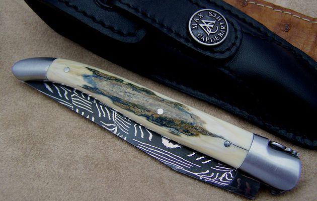 Couteau laguiole lame damas manche ivoire de mammouth cisele au burin