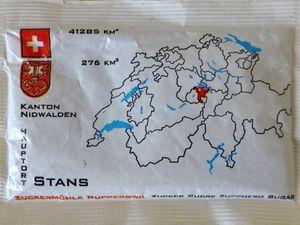 Stans au recto, son canton Nidwalden au verso, sachet de sucre en poudre suisse, Cl. Elisabeth Poulain
