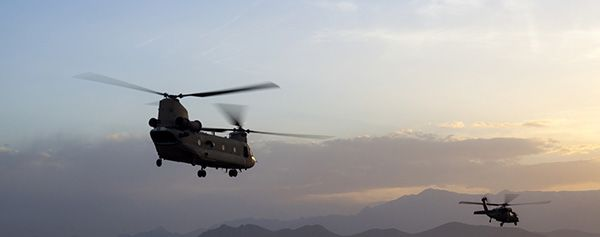 military_helicopters_flying_sunset_istockphoto_938643882_original_aerobernie