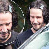 Keanu Reeves, 56, clips his dark locks back with hair slides
