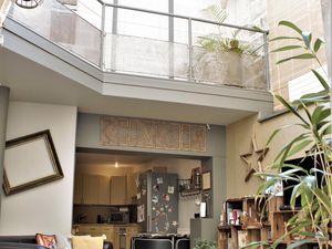 Ambiance loft indus pour une maison de ville