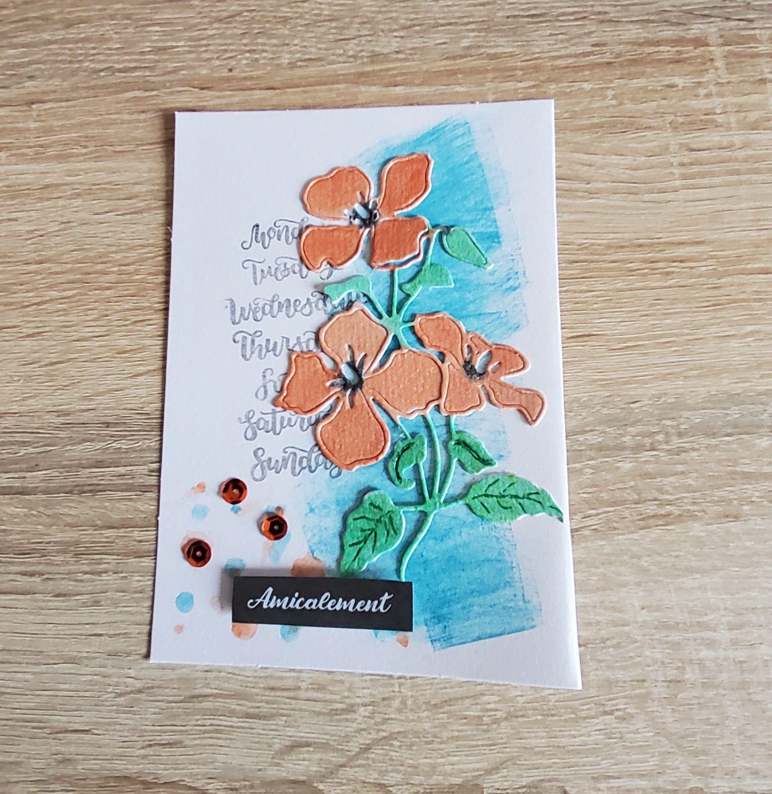 Encre, die de fleurs colorisées avec de l'aquarelle , tampon écriture, sequins.