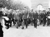 Charles De Gaulle on the Champs-Elysées / French Resistance in fight / US troops on the Champs-Elysées / Nowadays bullet impacts are still on some Parisian walls