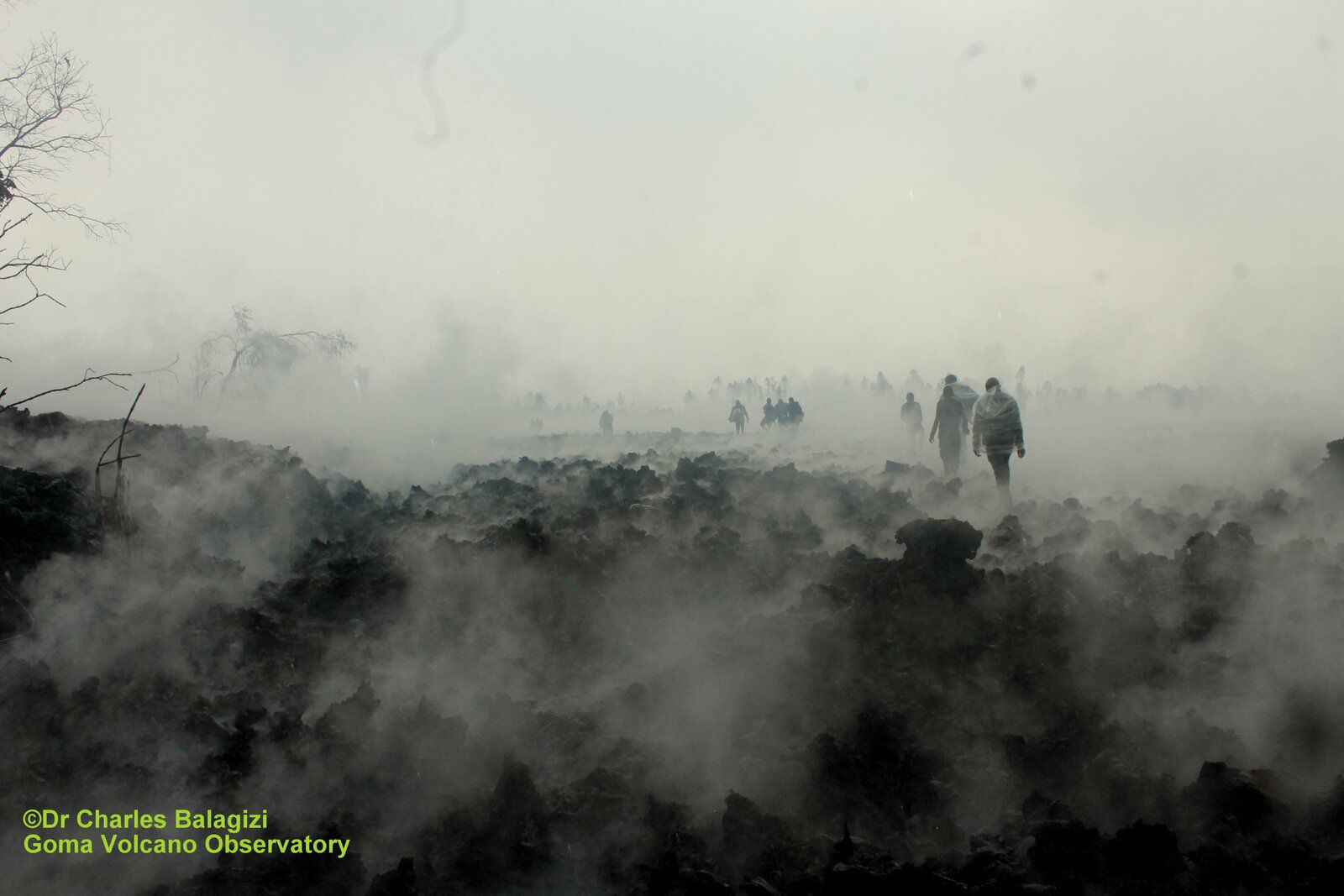 Goma - the inhabitants crossing the still very hot lava flow - photo Dr. Charles Balagizi