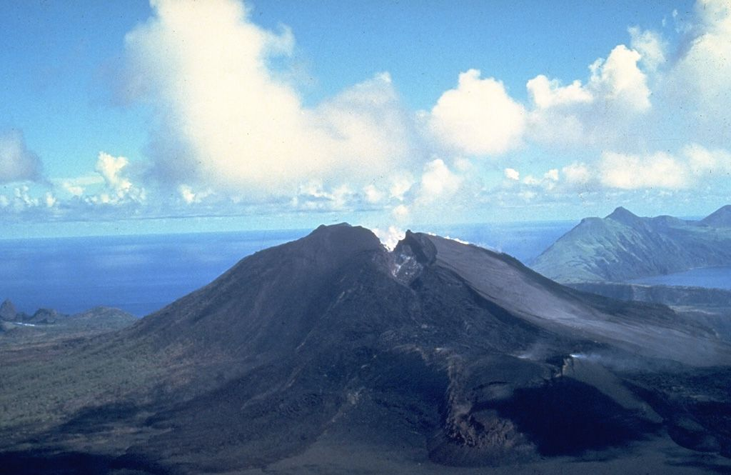 A crack that formed during an eruption of the North Pagan volcano in the Mariana Islands in 1981 crosses the summit of the volcano. Three main vents were active along the crack. U.S. Navy Photo, 1981 / via GVP