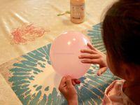 Ninette qui couvre le ballon d'huile