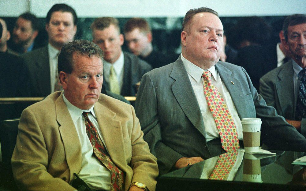 "FILE - ""Hustler"" magazine publisher Larry Flynt, right, and his brother Jimmy listen to the judge pass sentence after agreeing to a plea bargain with prosecutors in Hamilton County Court on May 12, 1999, in Cincinnati. Flynt, who turned ""Hustler"" magazine into an adult entertainment empire while championing First Amendment rights, has died at age 78. His nephew, Jimmy Flynt Jr., told The Associated Press that Flynt died Wednesday, Feb. 10, 2021, of heart failure at his Hollywood Hills home in Los Angeles. (AP Photo/Tom Uhlman, File)"