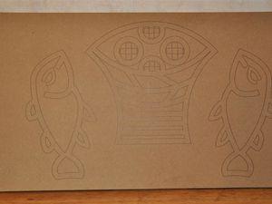 La mosaïque retravaillée par les enfants représente la multiplication des pains.