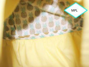 Détail des finitions avec mes biais maison tissu motif ananas et coton jaune