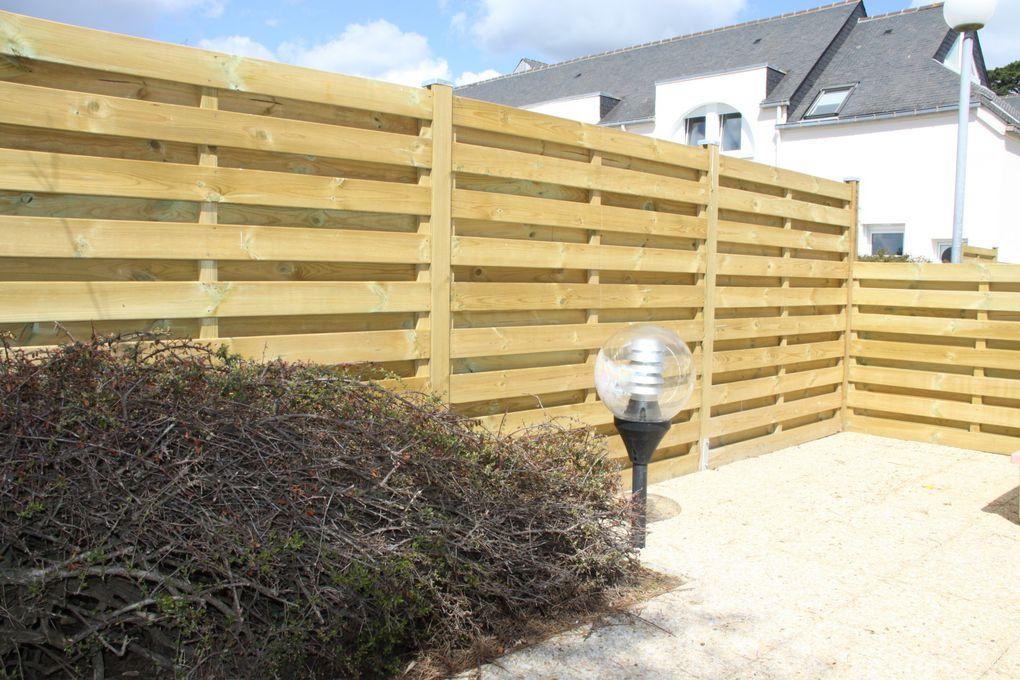 Arbor minéral paysagiste sur vannes et sa région pose pour vous portail et clôture